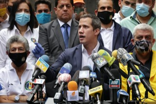Guaido addressing reporters in Caracas